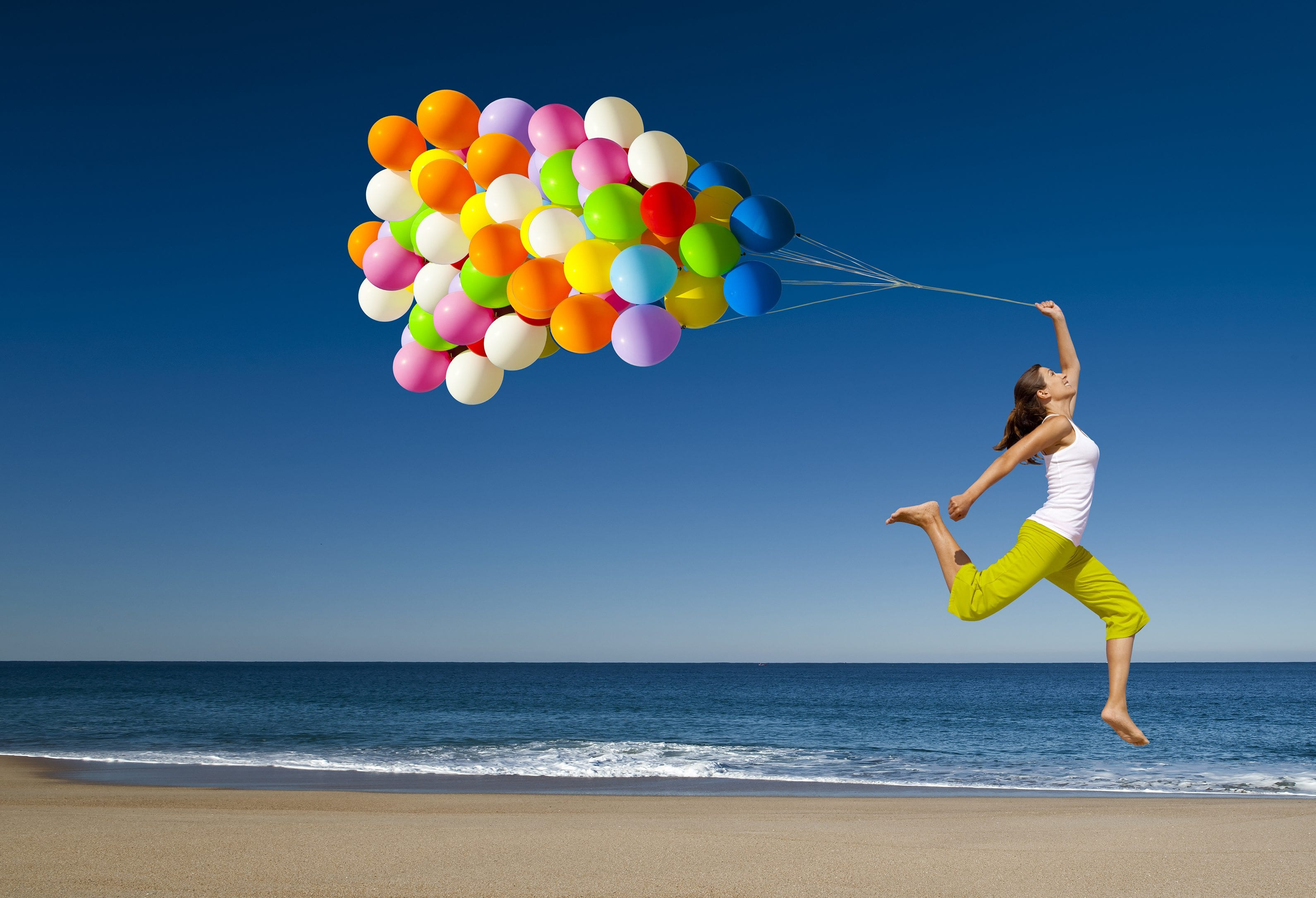 happy-woman-jumping-on-the-beach
