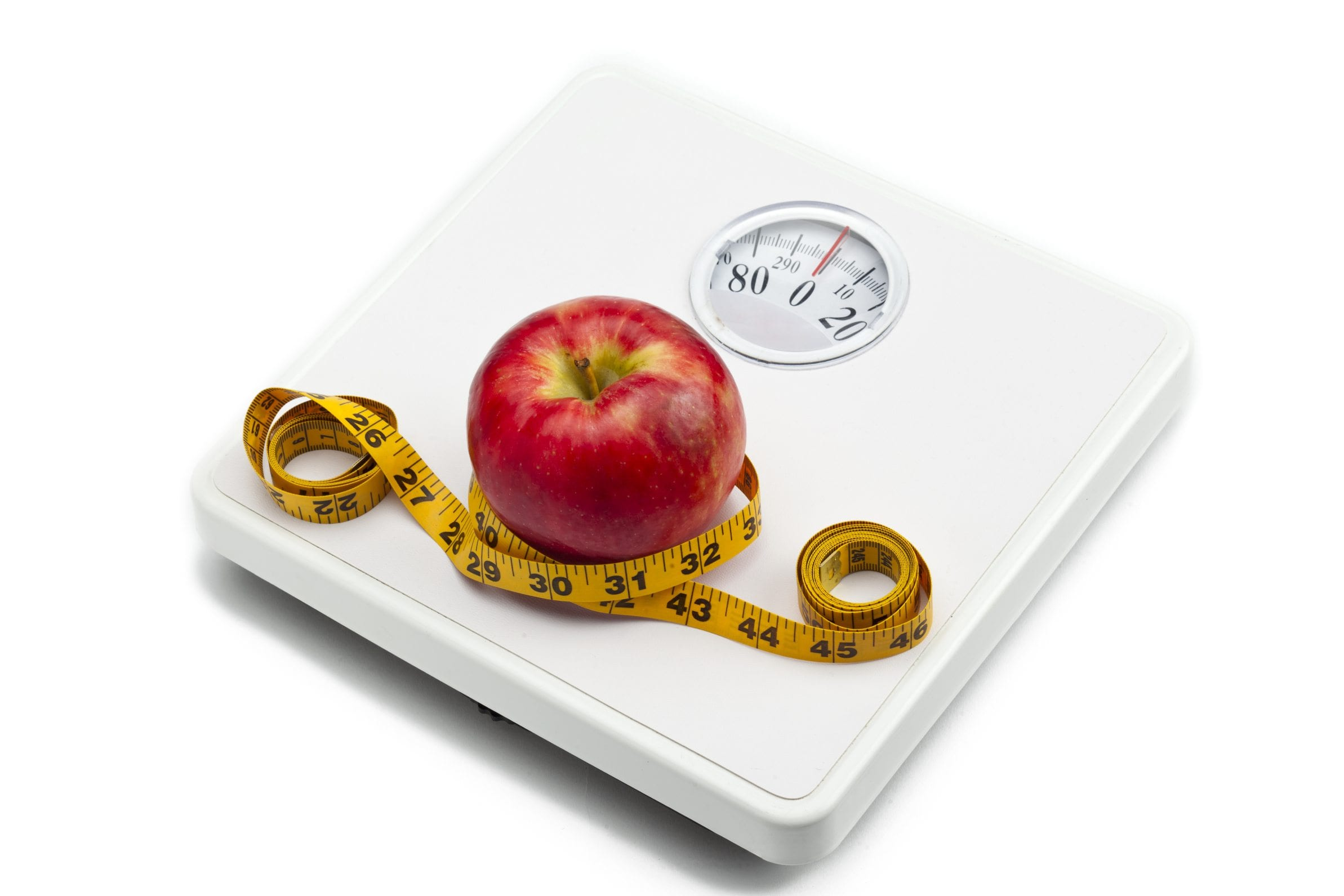 weight scale red apple and measuring tape