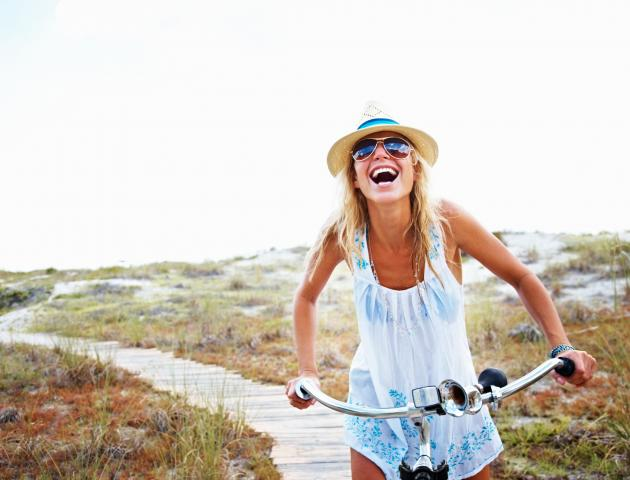 woman_cycling_laughing_-_157642220__medium_4x3